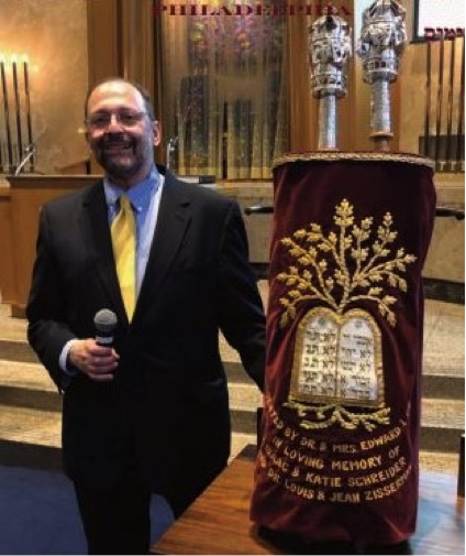 Ira with his great grandfather's Sefer Torah